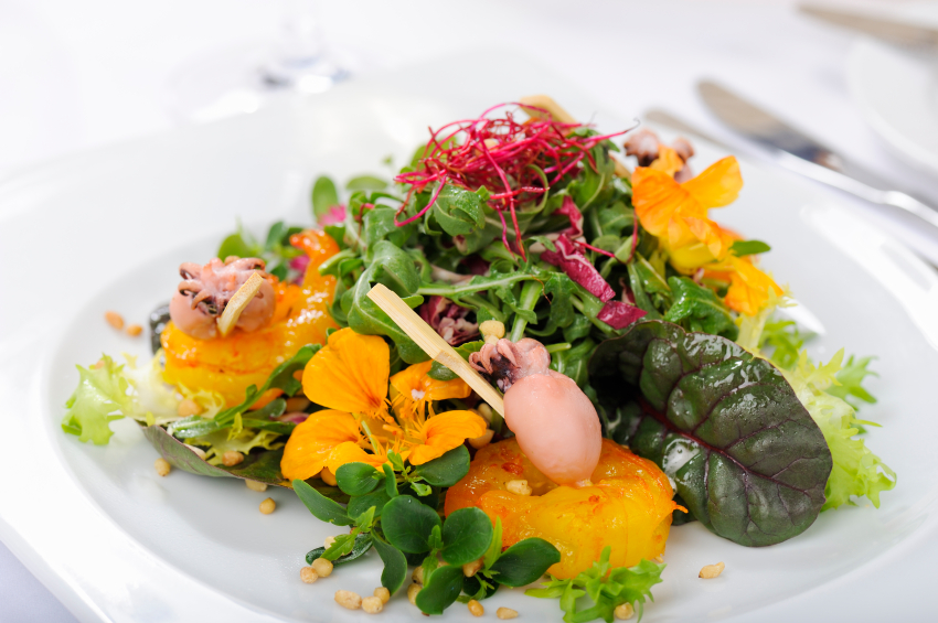 salad garnished with edible flowers