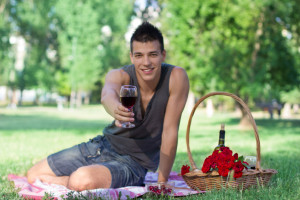 guy at picnic with wine