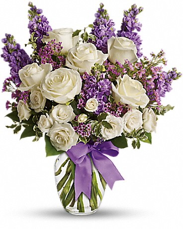 White roses and purple stock flowers