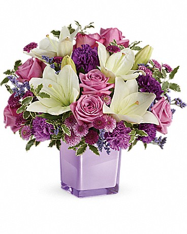 purple flowers in purple vase