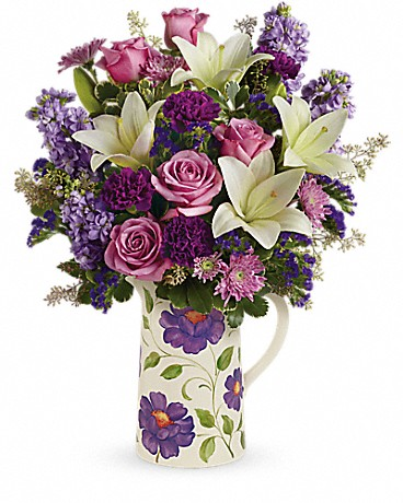 purple flowers in white and purple flower vase