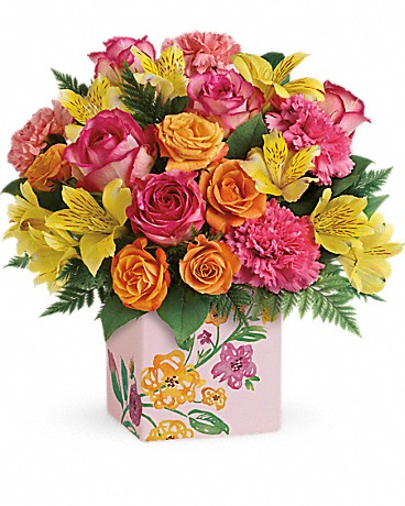 pink and orange flowers in pink cube vase