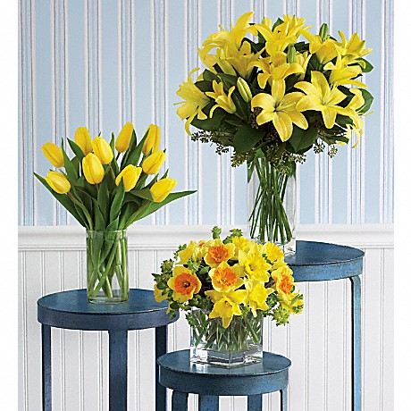 yellow flower bouquets in vases