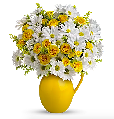 white daisies in yellow pitcher vase
