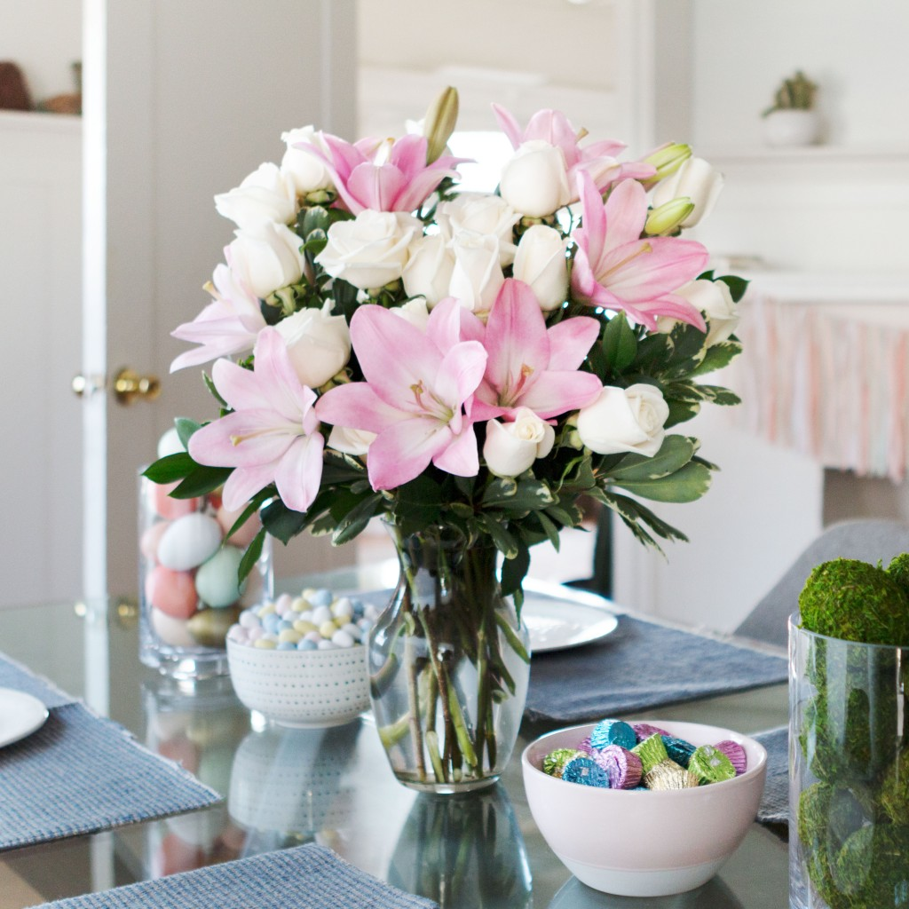 pink lilies and white roses in clear vase