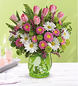 pink tulips and daisies in green lantern
