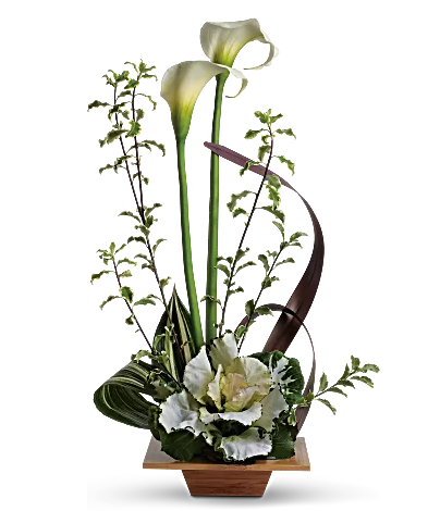 white calla lilies in bamboo dish
