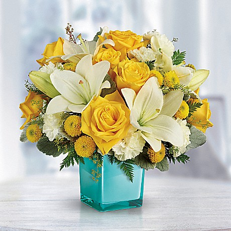 yellow and white flowers in aqua vase