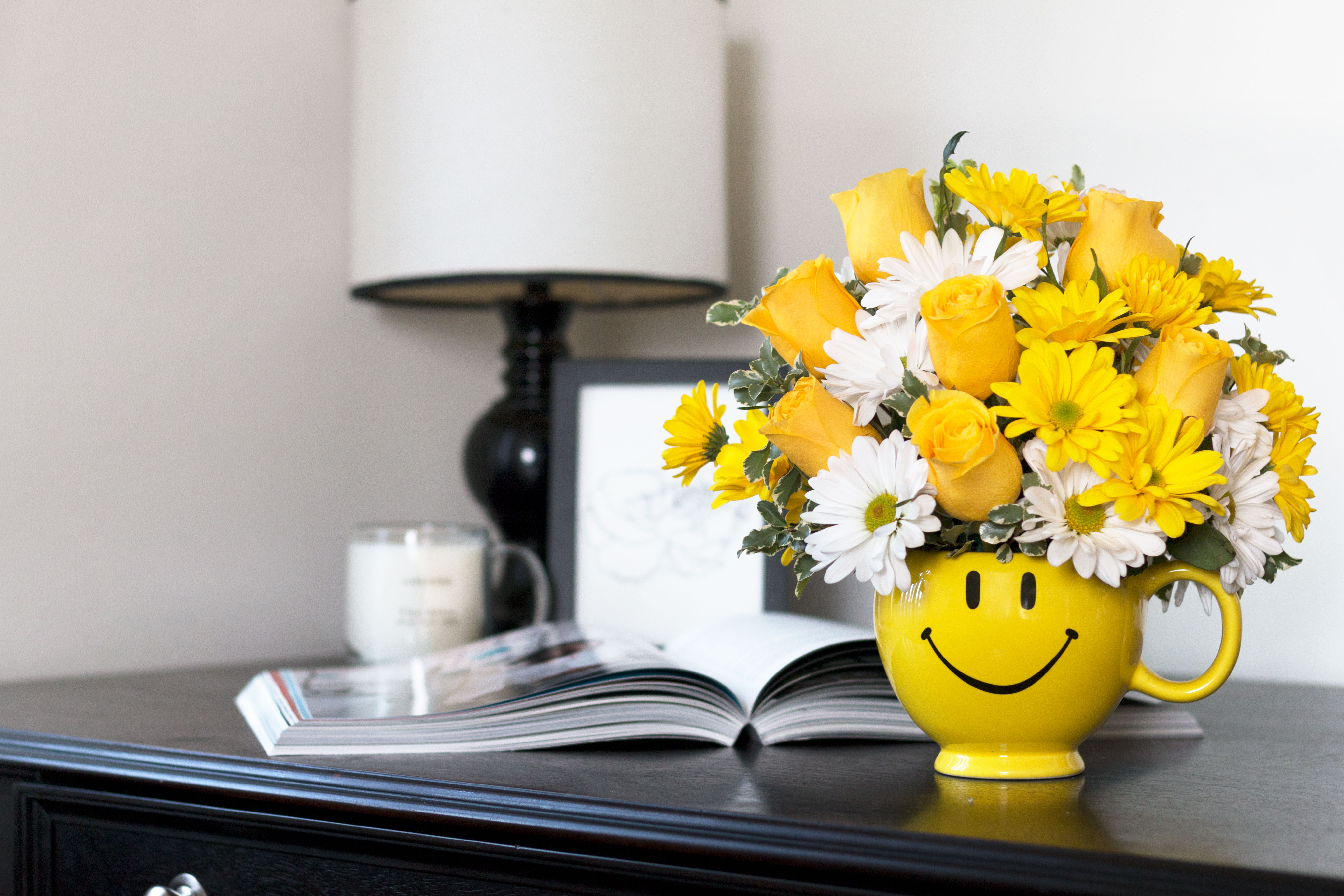 yellow roses and white daisies in yellow smile mug