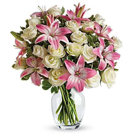 white roses and pink lilies in a clear vase