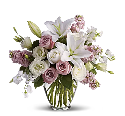 white roses, lilies, and sweet pea in a clear vase