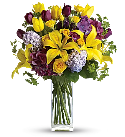 yellow and purple flowers in clear vase