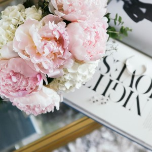 Light pink peonies and white peonies in pink vase