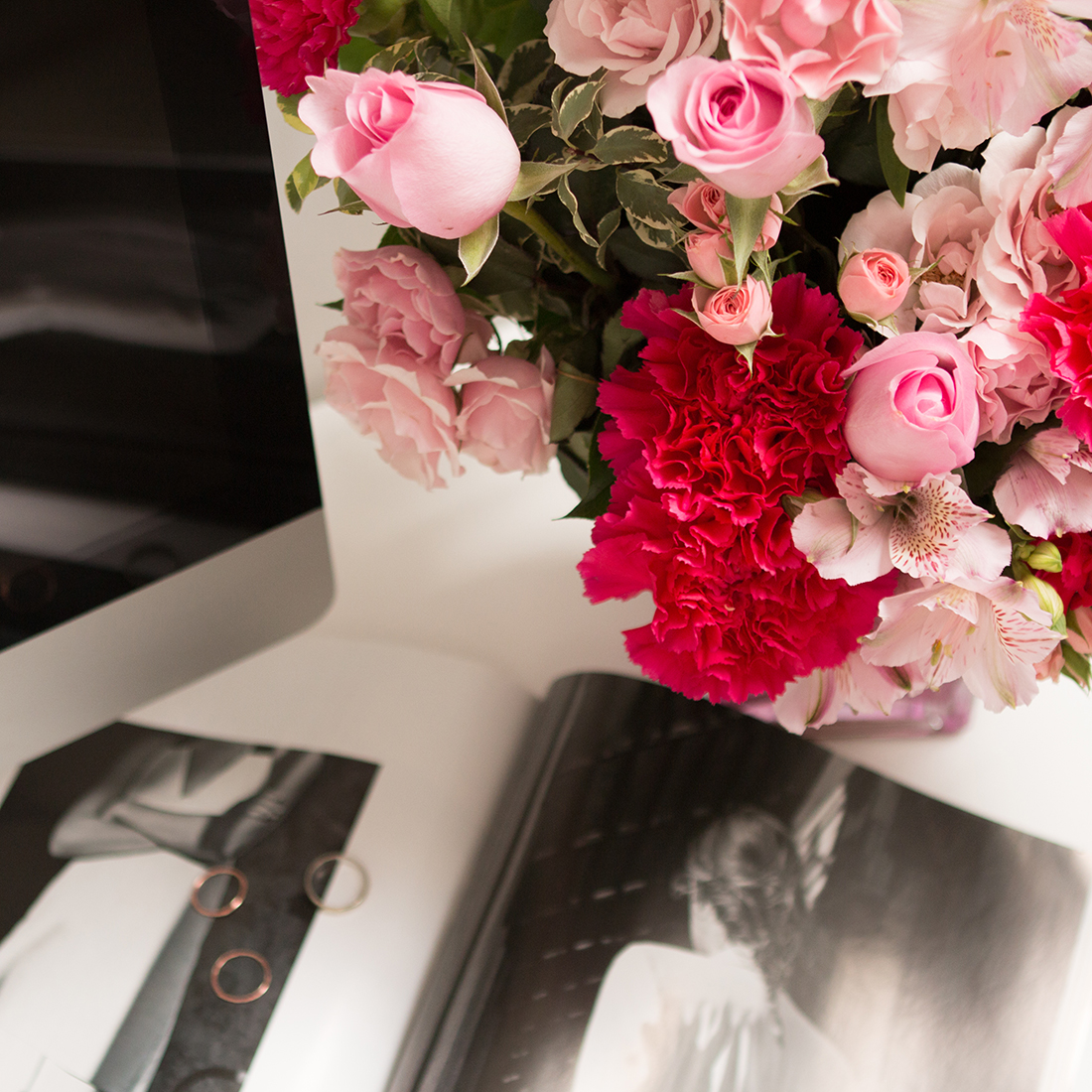 Teleflora's Pink Grace Bouquet- Pink roses, carnations, greenery, and more in cube vase.