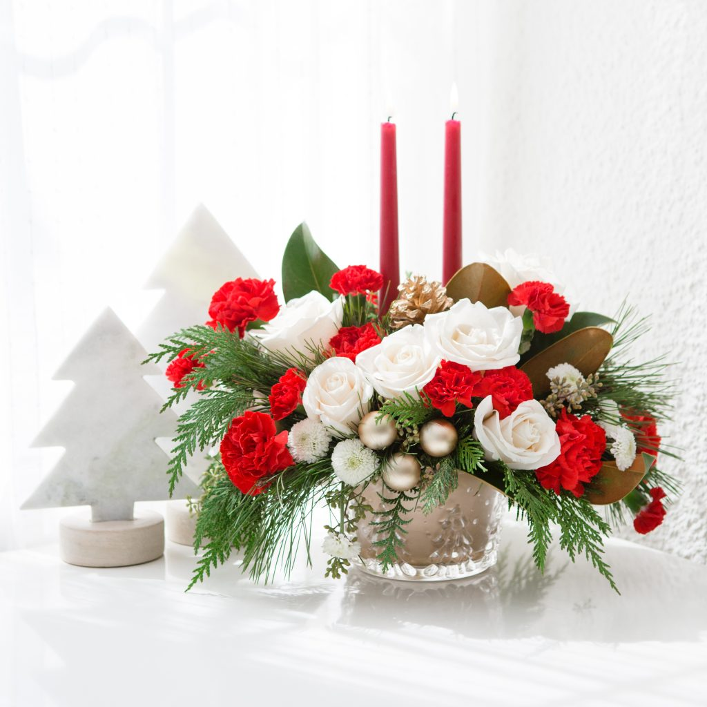 red and white flowers in gold centerpiece