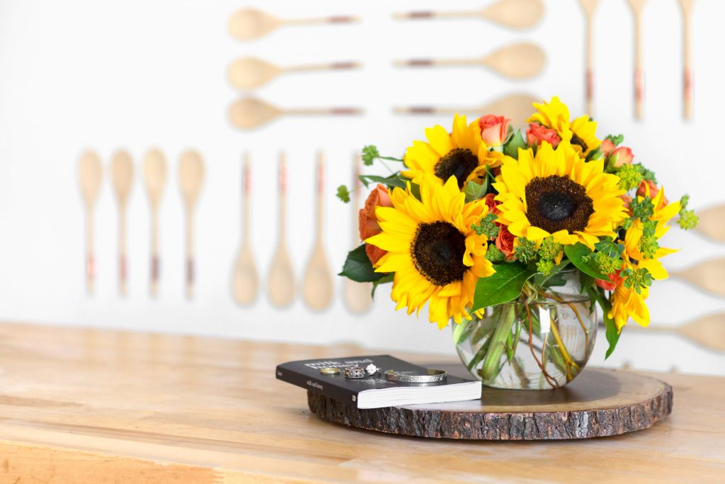 sunflowers and orange roses in bowl vase