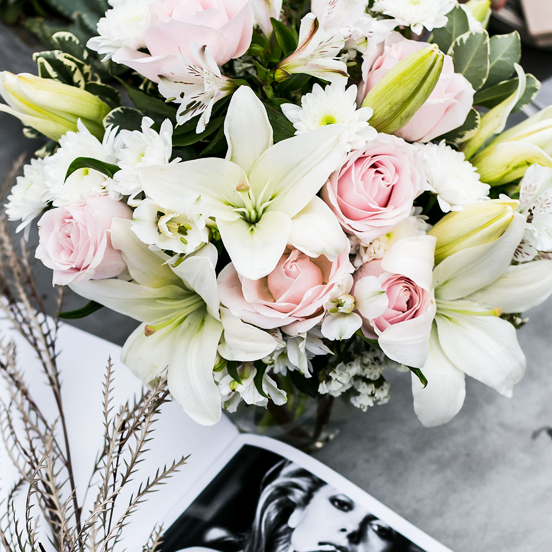 white lilies and pink roses close up