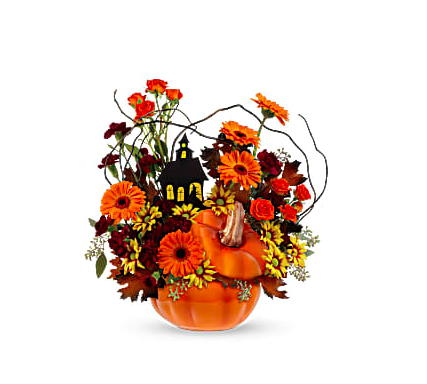 ceramic pumpkin filled with orange carnations, yellow daisies, and more