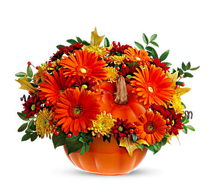 ceramic pumpkin filled with orange carnations, yellow mums, and greenery