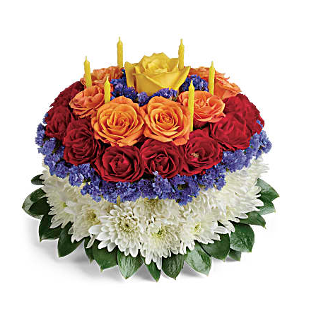 Orange roses, red roses, white cushion spray chrysanthemums, blue sinuata statice in the shape of a birthday cake
