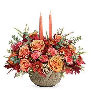 Orange roses, pink carnations, bronze mums and more in a stoneware bowl