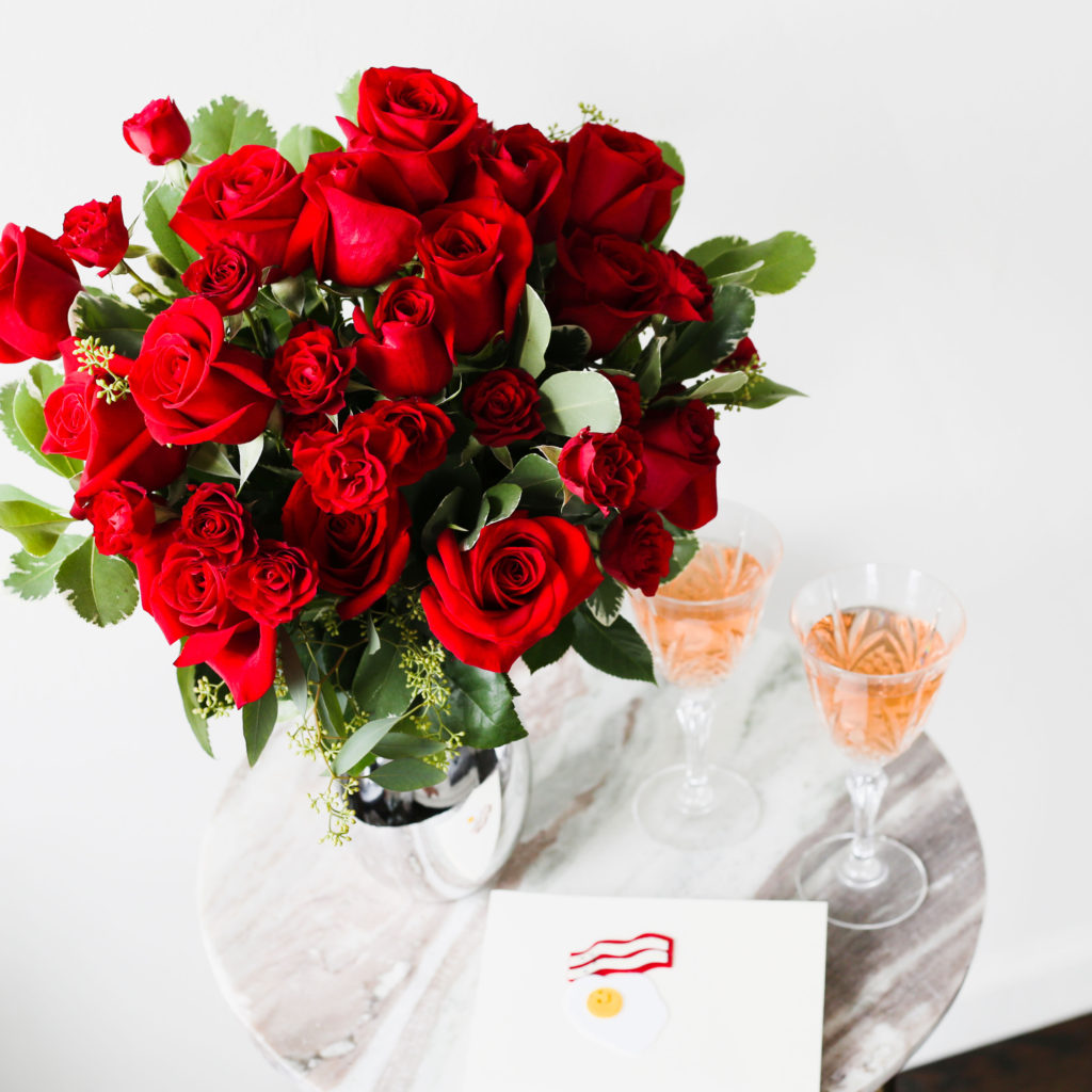 Close up on red roses and champagne