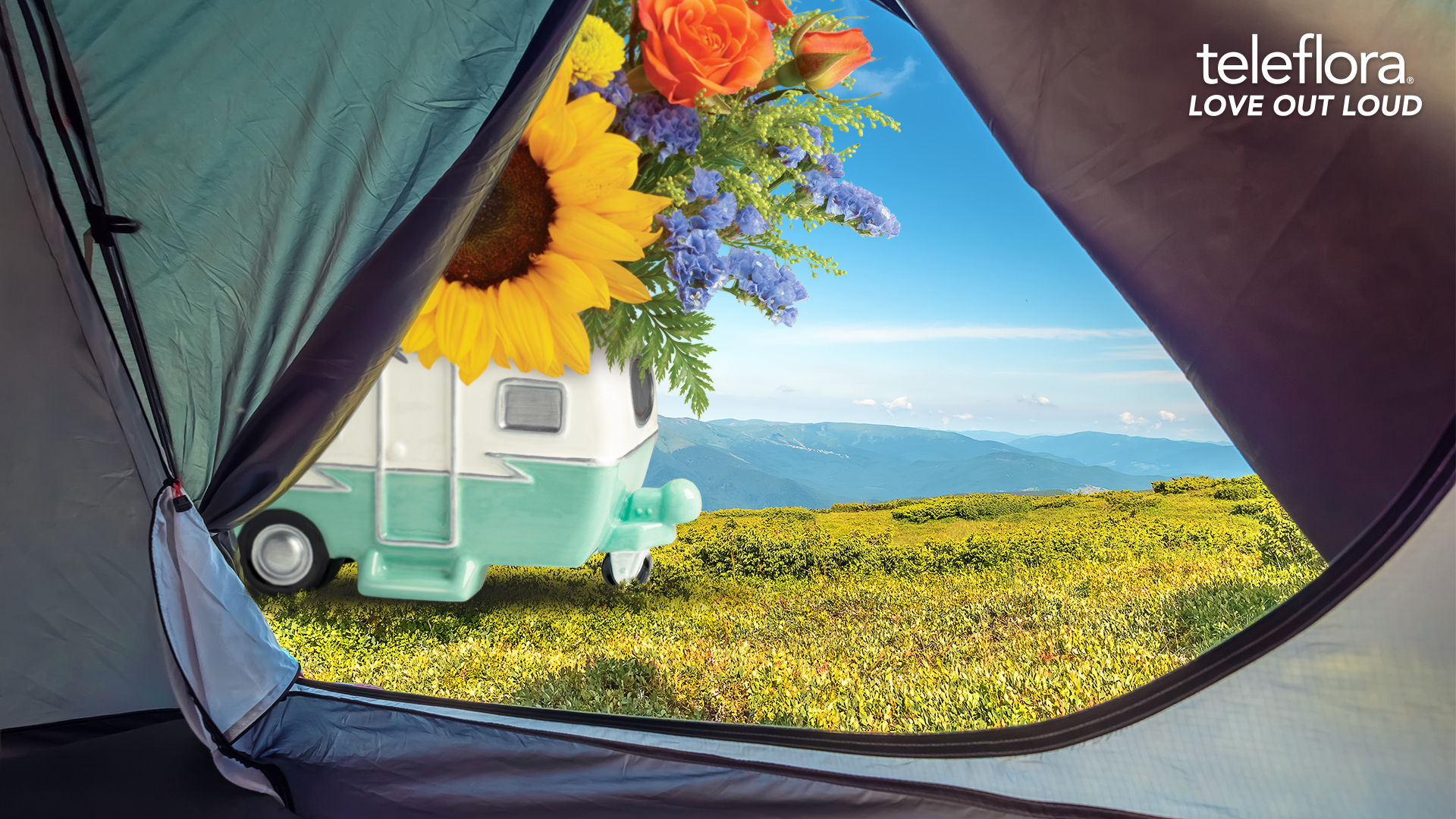 view from a tent to a camper and flowers
