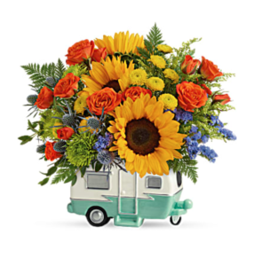 Sunflowers and roses fill a camper vase