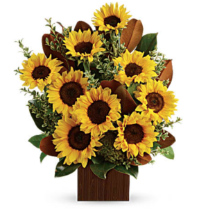 Sunflowers fill a bamboo cube container