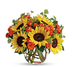 Sunflowers and orange roses in clear vase