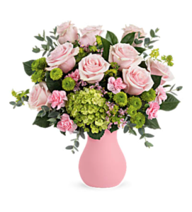 Pink and green flowers fill a pink vase